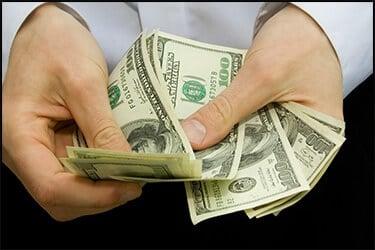 Hands counting money, 100 USD bills