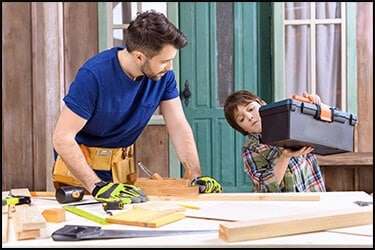 Father and son are building something out of wood