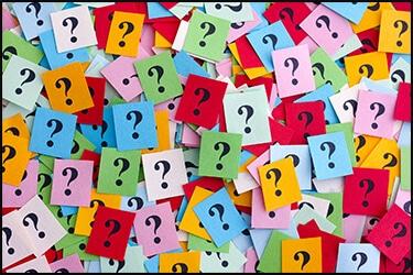 מלא סטיקרים צבעוניים עם סימני שאלה